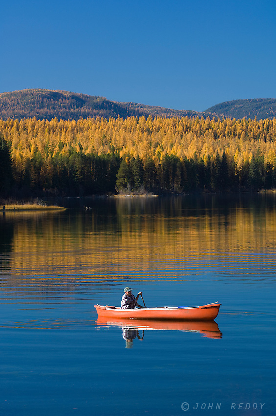 Canoe on Upper Stillwater Lake in fall-NW Montana