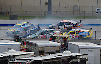 Jun 1, 2008; Dover, DE, USA; NASCAR Sprint Cup Series drivers Elliott Sadler (19) Denny Hamlin (11) Dale Earnhardt Jr (88) Scott Riggs (66) and Bobby Labonte (43) crash during a multiple car incident in the Best Buy 400 at the Dover International Speedway. Mandatory Credit: Mark J. Rebilas-US PRESSWIRE