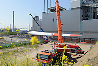 GERMANY Hamburg, construction of new Nordex wind turbine at treatment plant of Hamburg Wasser, the local water supplier, transport of rotor blades / DEUTSCHLAND Hamburg, Aufbau einer Nordex Windkraftanlage auf dem Gelaende Klaerwerk Koehlbrandhoeft von Hamburg Wasser, Anlieferung Nordex Rotorblaetter - More images as 120 MB Tiff available!