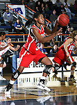 Nicholls State University Colonels forward LiAnn McMarthy (32) dribbles down court in the game between the UTA Mavericks and the  Nicholls State University Colonels  held at the University of Texas in Arlington's Texas Hall in Arlington, Texas. UTA defeats Nicholls 69 to 62