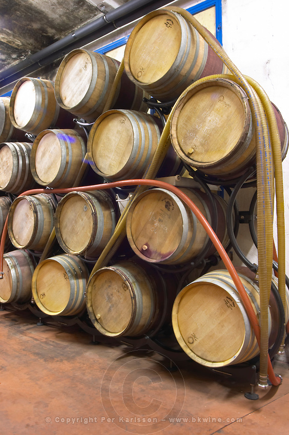 Domaine Madeloc, Banyuls sur Mer. Roussillon. Barrel cellar. Pumping tubes. France. Europe.