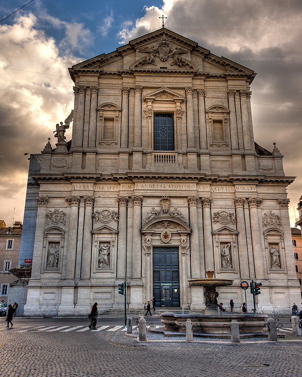 Backlit by late afternoon sunlight, the Church of Sant'Andrea della Valle seems to loom over the Via Vittorio Emanuele II and intersecting Corso del Rinascimento in the heart of Rome, Italy.  (HDR image)