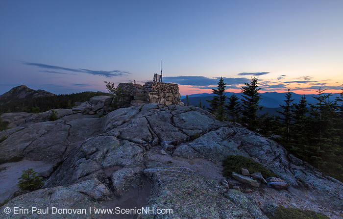 Sunset from Middle Sister Mountain in Albany, New Hampshire USA during the summer months. Mount Chocorua is in the background on the left.