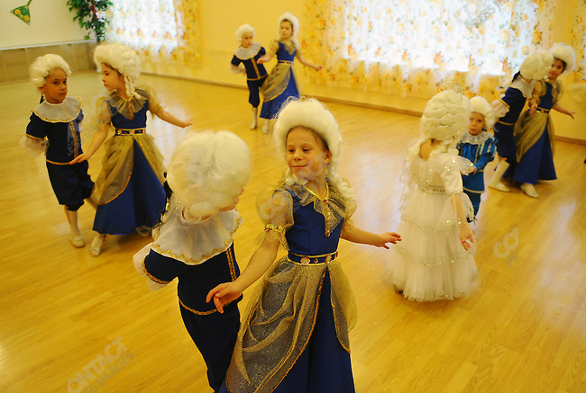 At Orphanage No.11 in Moscow boys and girls rehearsed a dance number in baroque costumes. Russia, April 23, 2010