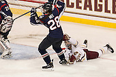 Kayla Mee (UConn - 28), Megan Keller (BC - 4) - The Boston College Eagles defeated the visiting UConn Huskies 4-0 on Friday, October 30, 2015, at Kelley Rink in Conte Forum in Chestnut Hill, Massachusetts.