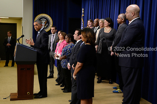 United States President Barack Obama, left, delivers remarks on the fiscal cliff at a White House event with middle-income Americans, at the Eisenhower Executive Office Building in Washington DC, USA, 31 December 2012. Congressional leaders are working towards a deal that would avert going over the fiscal cliff. According to reports, Congressional Republicans and the Obama administration are working on a compromise that would raise tax rates on couples making more than four hundred and fifty thousand dollars (three hundred and forty-one thousand euros) each year..Credit: Michael Reynolds / Pool via CNP
