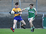 Mark Mc Inerney of  Clare  in action against Shane Bradshaw of  Limerick during their Munster Minor football quarter final at  Cusack Park. Photograph by John Kelly.