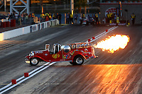 Mar 28, 2014; Las Vegas, NV, USA; NHRA wheelstander driver Ed Jones blows fire from his exhaust during qualifying for the Summitracing.com Nationals at The Strip at Las Vegas Motor Speedway. Mandatory Credit: Mark J. Rebilas-USA TODAY Sports