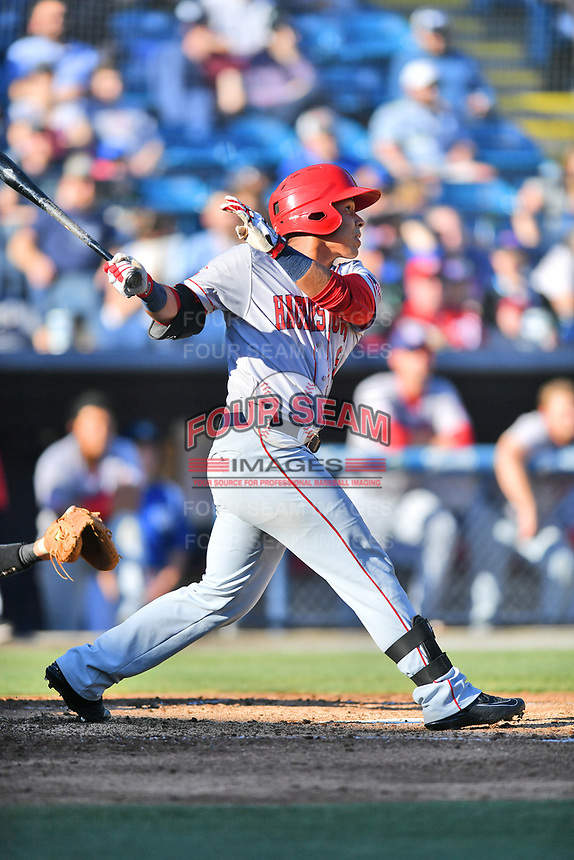 Hagerstown Suns designated hitter Oliver Ortiz (8) swings at a pitch during a game against the  Asheville Tourists at McCormick Field on May 13, 2017 in Asheville, North Carolina. The Suns defeated the Tourists 9-5. (Tony Farlow/Four Seam Images)