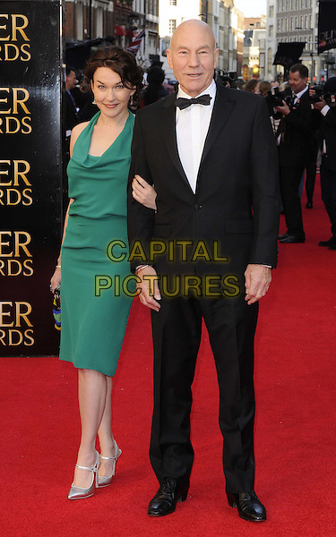 Sunny Ozell and Sir Patrick Stewart.The Olivier Awards 2012, Royal Opera House, Covent Garden, London, England..April 15th, 2012.full length green dress black tuxedo couple.CAP/CAN.©Can Nguyen/Capital Pictures.