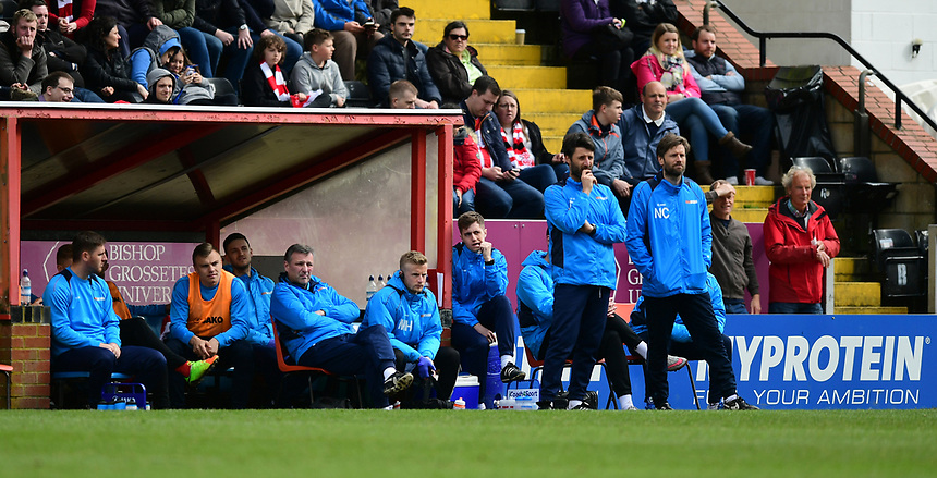 Lincoln City manager Danny Cowley, stood left, and Lincoln City's assistant manager Nicky Cowley, stood right, watch on from the dug out<br /> <br /> Photographer Chris Vaughan/CameraSport<br /> <br /> Vanarama National League - Lincoln City v Torquay United - Friday 14th April 2016  - Sincil Bank - Lincoln<br /> <br /> World Copyright &copy; 2017 CameraSport. All rights reserved. 43 Linden Ave. Countesthorpe. Leicester. England. LE8 5PG - Tel: +44 (0) 116 277 4147 - admin@camerasport.com - www.camerasport.com