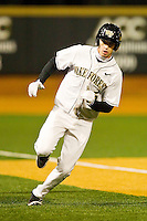 Evan Stephens #5 of the Wake Forest Demon Deacons rounds third base to score a run in the bottom of the 5th inning against the Maryland Terrapins at Wake Forest Baseball Park on March 9, 2012 in Winston-Salem, North Carolina.  The Demon Deacons defeated the Terrapins 10-5.  (Brian Westerholt/Four Seam Images)