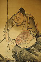 A hanging scroll of the fisherman Ebisu at a traditional hotel in Noto, Ishikawa prefecture, Japan, December 18, 2010.