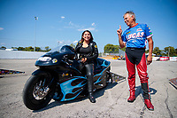 Sep 29, 2019; Madison, IL, USA; NHRA pro stock motorcycle rider Jianna Salinas (left) talks with Hector Arana Sr during the Midwest Nationals at World Wide Technology Raceway. Mandatory Credit: Mark J. Rebilas-USA TODAY Sports