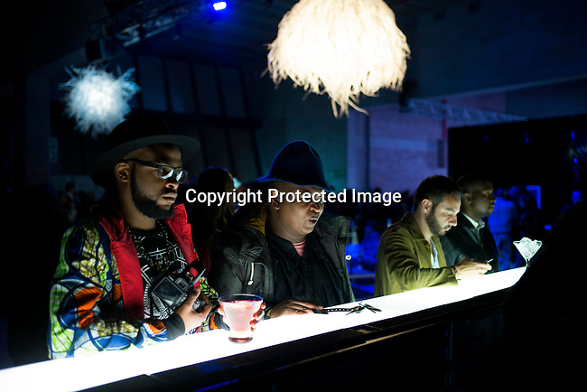 CAPE TOWN, SOUTH AFRICA JULY 4: Guests attending fashion shows have drinks before a show at South Africa Menswear week 2015 on July 4, 2015 in Cape Town, South Africa. The second edition of SAMW featured designers from South Africa and around Africa showing spring and summer collections during the 3-day event. (Photo by Per-Anders Pettersson)