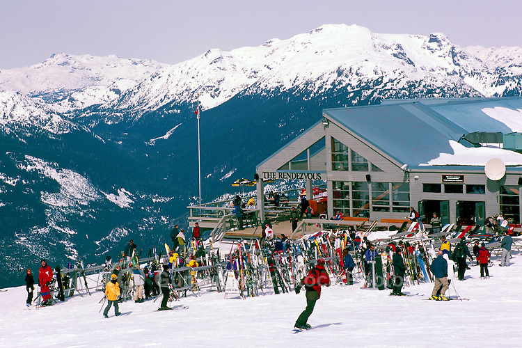 People downhill skiing and snowboarding at The Rendezvous Day Lodge, on Blackcomb Mountain at Whistler Resort, in the Coast Mountains, Whistler, British Columbia, Canada