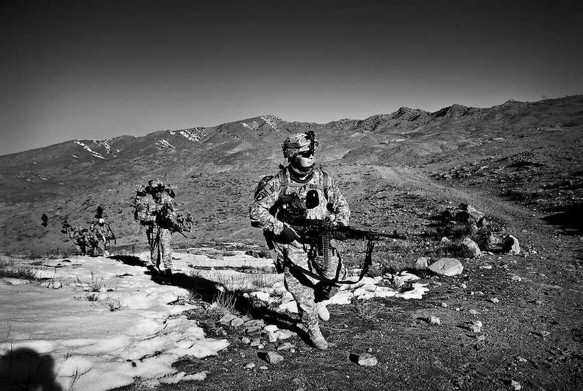 Conducting a search and clearing operation in a Taliban safe haven, members of Baker Company, 1/506th Infantry enter the village of Marzak, Paktika Province, Afghanistan, Thursday, Feb. 26, 2009.