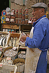 Sardine seller in Palermo market. Sicily, IT