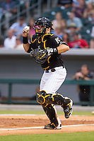 Charlotte Knights catcher Josh Phegley (4) chases a runner back towards third base during the game against the Pawtucket Red Sox at BB&T Ballpark on August 9, 2014 in Charlotte, North Carolina.  The Red Sox defeated the Knights  5-2.  (Brian Westerholt/Four Seam Images)