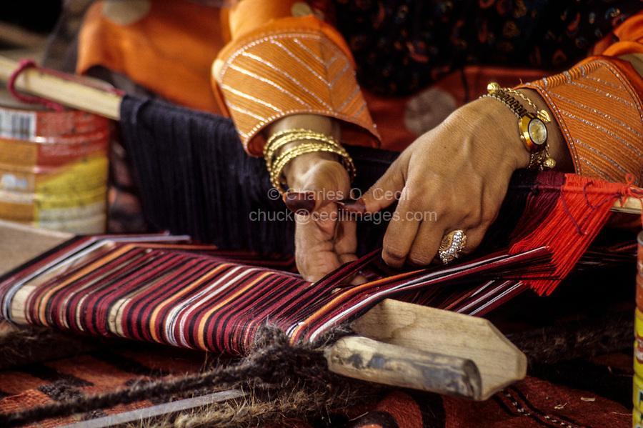 Oman.  Woman's Hands Weaving a Belt.