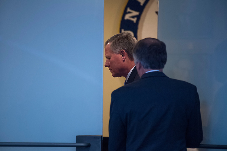 "UNITED STATES - MAY 11: Chairman Richard Burr, R-N.C., prepares to leave a meeting with Deputy Attorney General Rod Rosenstein, and Ranking Member Mark Warner, D-Va., after a Senate (Select) Intelligence Committee hearing in Hart Building titled ""World Wide Threats"" on May 11, 2017. (Photo By Tom Williams/CQ Roll Call)"