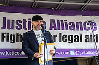 Greg Foxsmith (Criminal Defence Advocate and Justice Alliance Member). <br /> <br /> London, 23/02/2015. Today, the &quot;Justice Alliance&quot; and their Chris Grayling puppet dresses as King John Lackland arrived in Westminster for the last day of a tree-day march called &quot;Relay For Rights&quot; from Runnymede, birth place of the Magna Carta, to Old Palace Yard, where they held the &quot;Not the Global Law Summit&quot; rally. At the end of the demonstration outside the Houses of Parliament, protesters marched peacefully to the Queen Elizabeth II Centre where the &quot;Global Law Summit&quot; was taking place. From the organisers Facebook page: &lt;&lt; [&hellip;] February 23rd 2015 is the 799th and 8 month anniversary of the signing of the Magna Carta. The Government is using this non-anniversary to host the Global Law Summit, &quot;a unique opportunity to explore what the future holds for global business and the rule of law&quot;. This back-slapping corporate jamboree, partly funded by the Ministry of Justice, comes at a time when the same department has waged a slash-and-burn campaign on advice and representation, leaving people without deep pockets unable to get justice in court. Magna Carta represents the oldest historical commitment to equal access to justice in Britain. We are here to remind the Government of its duty to provide access to justice for all, and not merely to the rich. [&hellip;]&gt;&gt;<br /> <br /> For more information please click here: http://bit.ly/1G6aHZx