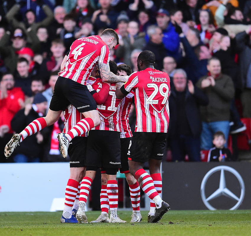 Lincoln City's Bruno Andrade celebrates scoring his side's second goal with team-mates<br /> <br /> Photographer Andrew Vaughan/CameraSport<br /> <br /> The EFL Sky Bet League Two - Lincoln City v Stevenage - Saturday 16th February 2019 - Sincil Bank - Lincoln<br /> <br /> World Copyright © 2019 CameraSport. All rights reserved. 43 Linden Ave. Countesthorpe. Leicester. England. LE8 5PG - Tel: +44 (0) 116 277 4147 - admin@camerasport.com - www.camerasport.com
