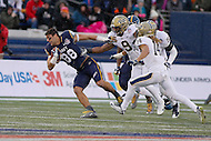 Annapolis, MD - December 28, 2015:     Navy Midshipmen wide receiver Tyler Carmona (88) runs with the ball after getting his helmet knocked off during the Military Bowl game between Pitt vs Navy at Navy-Marine Corps Memorial Stadium in Annapolis, MD. (Photo by Elliott Brown/Media Images International)