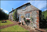 BNPS.co.uk (01202 558833)<br /> Pic: Strutt&amp;Parker/BNPS<br /> <br /> A former 16th century shepherd's cottage that was the childhood home of 50s matinee idol Dirk Bogarde is now an idyllic country retreat for anyone who wants to get away from it all.<br /> <br /> The distinguished film actor and writer, star of Doctor in the House (1954), The Servant (1963) and A Bridge Too Far (1977), lived at Winton Fields as a teenager with his parents and siblings during holidays from his school in Scotland.<br /> <br /> The pretty flint house is on the edge of the highly sought after and picturesque village of Alfriston, East Sussex, and has stunning views of the South Downs National Park.<br /> <br /> It is now on the market with Strutt &amp; Parker for a guide price of &pound;950,000.