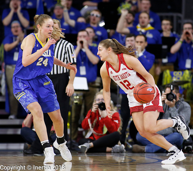 SIOUX FALLS, SD - MARCH 6:  Jaycee Bradley #12 of South Dakota drives to the basket on Tagyn Larson #24 of South Dakota State at the 2018 Summit League Basketball tournament at the Denny Sanford Premier Center in Sioux Falls. (Photo by Dick Carlson/Inertia)