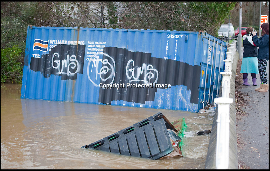 BNPS.co.uk (01202 558833)<br /> Pic: PhilYeomans/BNPS<br /> <br /> Container trapped by Iford Bridge...<br /> <br /> The River Stour at Christchurch, Dorset, broke its banks last night causing the Iford Bridge Home Park to be evacuated as 3 feet of flood water swept through.