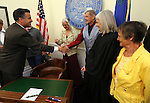 Nevada Gov. Brian Sandoval, left, greets members of the Friends of the Belmont Courthouse at the Capitol in Carson City, Nev., on Monday, May 6, 2013. From left center, Pat King, John King, Supreme Court Chief Justice Kris Pickering and Susan Terras were among those on hand for a brief ceremony to recognize the transfer of ownership of the historic courthouse from the state to Nye County. (AP Photo/Cathleen Allison)