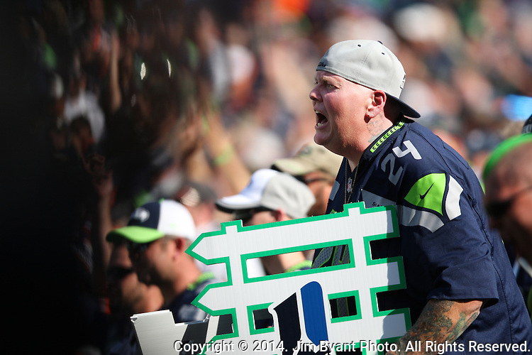 """Seattle Seahawks Seattle's biggest sports fan Lorin """"Big Lo"""" Sandretzky,  who hasn't missed a Seahawks home game in 28 years , cheers for the Seahawks in their game against the Denver Broncos  at CenturyLink Field in Seattle, Washington on September 21, 2014. The Seahawks won 26-20 in overtime.    ©2014. Jim Bryant Photo. All rights Reserved."""