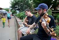 NWA Democrat-Gazette/DAVID GOTTSCHALK  Baron Lyle (right) and Felipe Antonio play jazz standards Thursday, June 15, 2017, on the southeast corner at the Fayetteville Farmers Market on the downtown square. The market will be open until November on Saturdays from 7:00 am - 2:00 pm, and Tuesdays and Thursdays from 7:00 am to 1:00 pm.