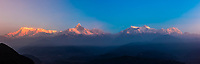 Panoramic view of the Annapurna Massif (range). It includes the 10th highest mountain in the world, Annapurna 1 at 26,545 ft. (8091 m). Peaks left to right: Annapurna South, Annapurna 1, Hiunchuli, Machapuchare (aka Fishtail); Annapurna III, Annapurna IV, Annapurna II and Lamjung Himal. Seen fromSarangkot,  near Pokhara, Nepal.