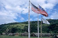 Flags of USA,  US army and Vanuatu in Sulphur Bay Village, Ipekel Ipeukel, Tanna Island, Vanuatu.