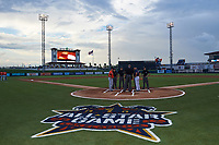 General view of the lineup exchange between managers Gera Alvarez (left) of the Bradenton Marauders and Jay Bell (right) of the Tampa Yankees, with umpires Greg Roemer, Reid Joyner, Jose Navas, Derek Thomas, J.C. Velez, and Sean Shafer-Markle, before Florida State League All-Star Game on June 17, 2017 at Joker Marchant Stadium in Lakeland, Florida.  FSL North All-Stars  defeated the FSL South All-Stars  5-2.  (Mike Janes/Four Seam Images)