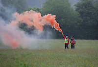 Pictured: Mountain rescue men with a flare help guide a Coastguard helicopter to its landing site at Tafarn y Gerreg in Powys, Wales UK. Wednesday 29 June 2016<br />