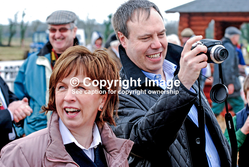 Diane Dodds, Democratic Unionist Party, candidate, June 09, European Elections, was one of a number of politicians, who attended the event to raise their profile. She is seen with her camera-toting husband, Nigel Dodds, finance minister, N Ireland Assembly. Taken 28 February 2009 at 95th annual ploughing match of Mullahead &amp; District Ploughing Society, Co Down, N Ireland, UK, 200902281901.<br />