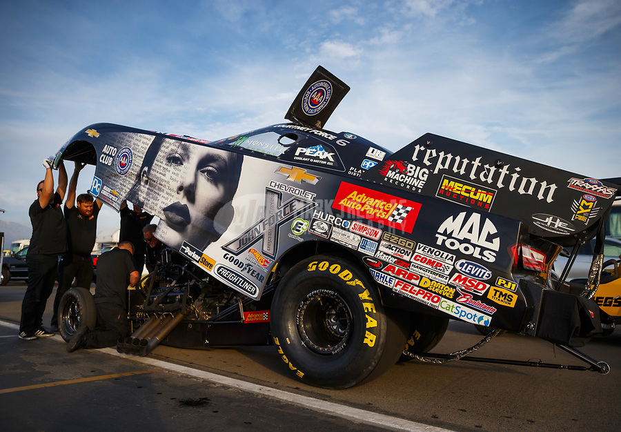 "Nov 10, 2017; Pomona, CA, USA; Crew members work on the car of NHRA funny car driver Courtney Force in her Taylor Swift themed car to promote her new album ""Reputation"" during qualifying for the Auto Club Finals at Auto Club Raceway at Pomona. Mandatory Credit: Mark J. Rebilas-USA TODAY Sports"