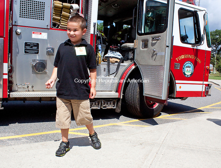 TORRINGTON CT.-28 AUGUST 2013 082813DA08- Torringford School kindergartner David Woodruff won the chance to get a ride in a fire truck on the first day of school on Wednesday. The prize was given as part of the Torrington Early Childhood Collaborative incentive for parents to register there children on time for Kindergarten. Once students are registered, their name is put into a raffle for a ride on the first day of kindergarten on a fire truck.<br /> Darlene Douty Republican American