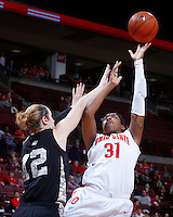Ohio State Buckeyes guard Raven Ferguson (31) is guarded on a shot by Army Black Knights forward Olivia Schretzman (12) during the second half of Friday's NCAA Division I basketball game at Value City Arena in Columbus on December 13, 2013. Ohio State won the game 59-56. (Barbara J. Perenic/The Columbus Dispatch)