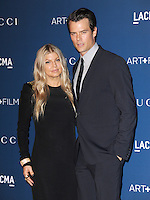 LOS ANGELES, CA - NOVEMBER 02:  Stacy Duhamel (nee Ferguson) aka Fergie &amp; Josh Duhamel at  LACMA 2013 Art + Film Gala held at LACMA  in Los Angeles, California on November 2nd, 2012 in Los Angeles, CA., USA.<br /> CAP/DVS<br /> &copy;DVS/Capital Pictures