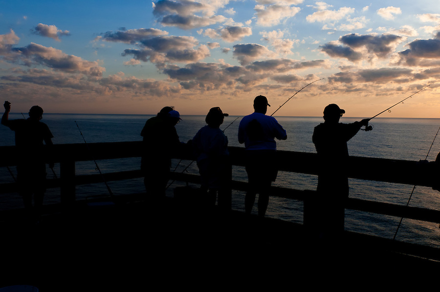 Group of people fishing in the morning from a wharf