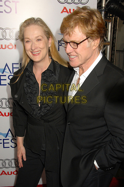 "MERYL STREEP & ROBERT REDFORD.AFI FEST 2007 Opening Night Gala Premiere of ""Lions for Lambs"" at the Cinerama Dome, Hollywood, California, USA..November 1st, 2007.half length black suit hand in pocket ruffles ruffled top jacket glasses .CAP/ADM/BP.©Byron Purvis/AdMedia/Capital Pictures."