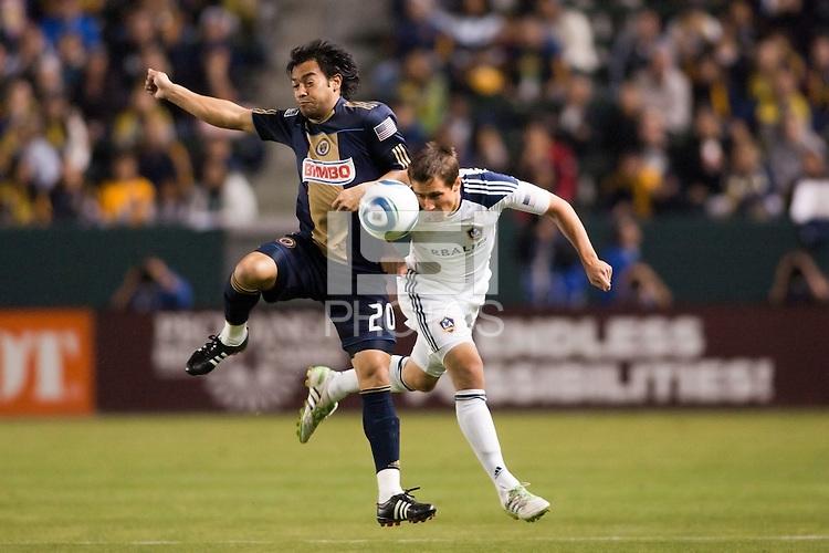 Carlos Ruiz (20) of the Philadelphia Union and Todd Dunivant (2) of the LA Galaxy battle. The LA Galaxy defeated the Philadelphia Union 1-0 at Home Depot Center stadium in Carson, California on  April  2, 2011....