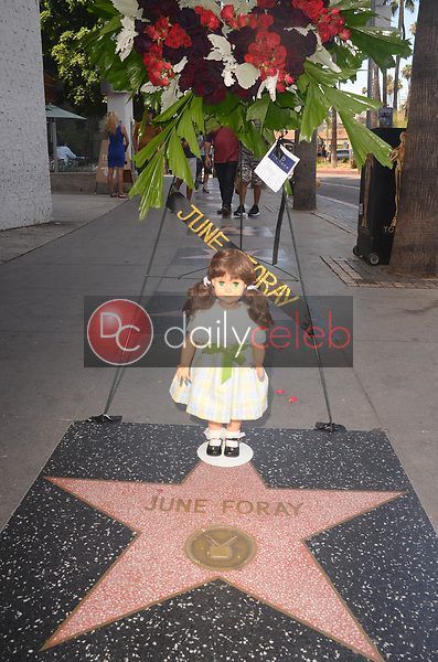 """Flowers placed on the Star of June Foray<br /> Flowers Placed on the Star of June Foray, and also a fan-placed """"Talky Tina"""" doll - the character Foray voiced in """"The Twilight Zone,"""" Hollywood Walk of Fame, Hollywood, CA 07-27-17<br /> David Edwards/Dailyceleb.com 818-249-4998"""
