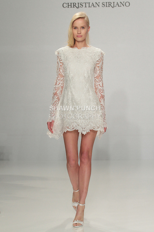 Model walks runway in a long sleeve lace dress, from the Christian Siriano for Kleinfeld bridal collection, at Kleinfeld on April 18, 2016 during New York Bridal Fashion Week Spring Summer 2017.