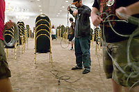 Attendees of the 6th edition of HOPE, an annual hackers' convention, help gather cables after the closing event, July 23rd 2006, New York City, USA.