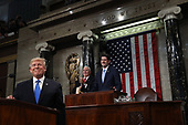 WASHINGTON, DC - JANUARY 30:  U.S. President Donald J. Trump (L) stands at the podium as U.S. Vice President Mike Pence (C) and Speaker of the House U.S. Rep. Paul Ryan (R-WI) (R) look on during the State of the Union address in the chamber of the U.S. House of Representatives January 30, 2018 in Washington, DC. This is the first State of the Union address given by U.S. President Donald Trump and his second joint-session address to Congress.  <br /> Credit: Win McNamee / Pool via CNP